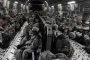 U.S. Army soldiers from 4th Brigade, 2nd Infantry Division, are seen Friday on board a military aircraft in Baghdad as they begin their journey home. These soldiers are part of the last brigade of combat troops that are now leaving Iraq, heading home as part of the U.S. drawdown of forces.