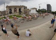 A blur of cyclists race past Kansas City's Union Station on Sept. 13, 2009, during the Tour of Missouri. Smack in the middle of the country, it is people at Union Station who generally scurry in different directions as they pursue their destinations. In 2010, a year of fragmentation if there ever was one, watching them scatter is not unlike how American voters view politics.