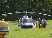 Medical personel carry an injured man to a Life Star helicopter after he was injured while working in a trench Monday afternoon, Aug. 16, 2010, o land near East 750 Road and North 100 Road in rural Douglas County, west of Baldwin City. The man was working on a dam for a pond.