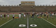 Free State High School's marching band practices Tuesday at the school.