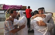 Family members of Saif Ali, 24, grieve Tuesday during his funeral in Najaf, south of Baghdad. Ali was killed when a suicide bomber sat for hours Tuesday among hundreds of army recruits before detonating nail-packed explosives strapped to his body, killing and wounding dozens of them and casting new doubt on the ability of Iraqi forces as U.S. troops head home.