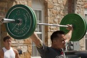 Chad Richards does an Olympic lift as part of the workout regimen for the Next Level Strongman competition.