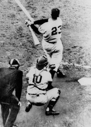 Bobby Thomson, of the New York Giants, hits a home run. The ninth-inning homer against the Brooklyn Dodgers clinched the National League Pennant for the Giants on Oct. 3, 1951.