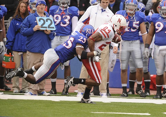 Kansas safety Darrell Stuckey, left, tries to bring down Nebraska wide receiver Niles Paul on Nov. 14, 2009, in Lawrence.
