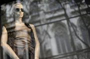 A mannequin is displayed Saturday in the window of the Saks Fifth Ave flagship store on New York's Fifth Ave. Upscale department store Saks Inc. said Tuesday its second-quarter loss narrowed as margins improved because it was able to sell more products at full-price and rely less on sales.