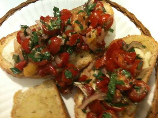 Bruschetta with local tomatoes, basil and parsley.