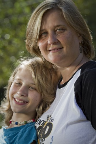Karla Knudson, right, is getting her head shaved with 45 other women from around the country who also have kids who had cancer. Annika Kundson, 13, left, had Burkitt's lymphoma but has been cancer-free for 14 months now.