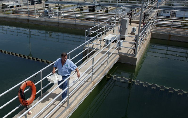 Steve Hall, utility operator at the Kaw River Water Treatment Plant, makes his rounds in this August 2010 file photo, collecting samples of water from the basins at the plant. Many Lawrence residents at the time complained about their water tasting and smelling musty. Officials at the plant attributed the problem to byproducts of algae.
