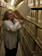 Valoise Armstrong, an archivist at the Dwight D. Eisenhower Presidential Library, pulls a box of White House files from the library's archives in Abilene. In July, Armstrong discovered among the library's papers a document written by a federal judge in 1794.