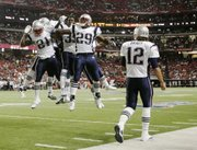 New England Patriots running back Fred Taylor (21) reacts with teammates, including Chris Taylor (29), after Fred Taylor scored a touchdown in the first quarter against the Falcons. The Patriots beat the Falcons, 28-10, in the preseason game on Thursday in Atlanta.