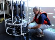 Hydrographer Rachel Medley takes a sample from a water column sampler that was recovered from the Gulf of Mexico on Friday on board the NOAA Ship Pisces about 9 miles south of the Deepwater Horizon oil wellhead near the coast of Louisiana. New guidelines were released Friday that hinted that those closest to the oil might have the best chance of winning an emergency claim.