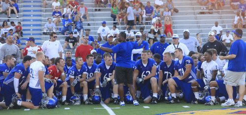 New KU coach Turner Gill addresses his team at Fan Appreciation Day on Aug. 22.