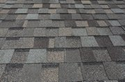 The overlapping pattern used in asphalt shingle installation means there are two rows of nails holding each shingle in place.
