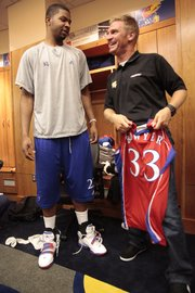 Kansas junior Marcus Morris, left, talks with NASCAR driver Clint Bowyer in the KU locker room on Tuesday.