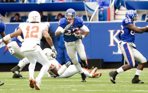KU running back Angus Quigley (22) finds a gap in the Texas defense on Nov. 15, 2008, in Lawrence.