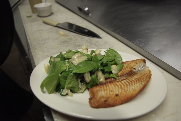 23rd Street Brewery offers several healthy entres, including Tilapia Florentine. The dish is pan seared tilapia topped with toasted almonds and feta cheese, and served with sauteed spinach and artichokes. Such dishes are part of a new LiveWell EatWell intiative in Lawrence.