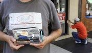 Typo sleuth Jeff Deck holds his typo repair kit.