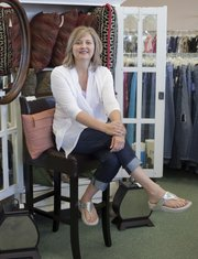 Susan Cook, owner of Lasting Impressions, 711 W. 23rd. St., has translated her love for affordable designer clothes into a career.