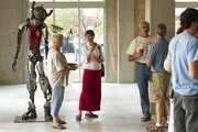 A sculpture named Robot Guardian watches as spectators gather during the Final Fridays art gallery walk Aug. 27, 2010. 