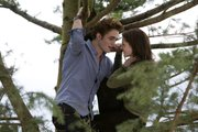 "Robert Pattinson and Kristen Stewart are shown in a scene from ""Twilight"" in this file image released by Summit Entertainment. Along with younger fans, some moms are also looking forward to the last two ""Twilight"" movies starting next year, and they're scooping up all sorts of reads intended for the young."