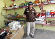 Ahmed Adnan Abdul Hasan stands Sunday in his shop in al-Faris village in Iraq.