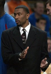 Senior Keith Langford sports a suit and tie, instead of a jersey, during KU's Big 12 tournament semi-final game with Oklahoma State Saturday, March 12, 2005 at Kemper Arena in Kansas CIty. Langford was battling a bad reaction to painkillers which was causing his kidneys to shut down.