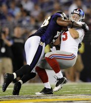 Baltimore Ravens linebacker Edgar Jones sacks New York Giants quarterback Rhett Bomar (5) during the second half of an NFL preseason football game on Saturday in Baltimore. The Ravens topped the Giants, 24-10, to move to 3-0 this preseason.