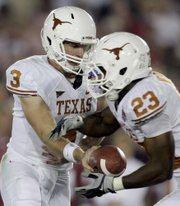 Texas quarterback Garrett Gilbert, left, hands off to running back Tre Newton in the BCS Championship on Jan. 7. The Longhorns will rely on running backs Newton, Fozzy Whittaker and Cody Johnson to power their offense this season.