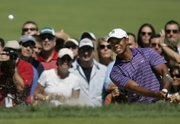 Tiger Woods chips out of a bunker to the fifth green during the third round of The Barclays golf tournament on Saturday in Paramus, N.J.