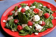 Chicken and Spinach Stir-Fry Salad with Raspberries.