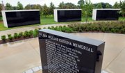 Three mausoleums are seen Friday at the New Orleans Katrina Memorial Park. A total of six mausoleums at the memorial hold the remains of 80 hurricane victims who were either unidentified or unclaimed years after the 2005 storm.