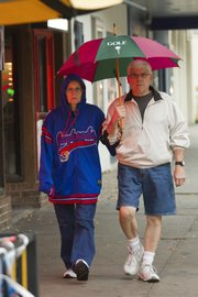 Rainy weather showed up Thursday, Sept, 2, 2010, during a pep rally block party on Mass Street. Dressed for the event and the changing weather, Geraldine and Jerry Thomas of Lawrence showed up for their support for KU football.
