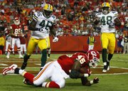 Kansas City Chiefs tight end Leonard Pope (45) lands in the end zone for a touchdown in front of Green Bay Packers safety Charlie Peprah (46) and linebacker Alex Joseph in the first half. The Chiefs beat the Packers, 17-13, Thursday in Kansas City, Mo.