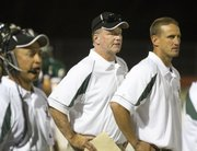 Free State head coach Bob Lisher watches from the side lines during the Firebird's season opening victory against Olathe South Friday night.