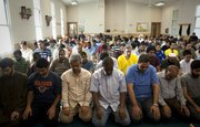Men kneel for afternoon prayer on Friday, Sept. 3, 2010, at the Islamic Center of Lawrence. Many Muslims in Lawrence say the city's diverse cultural makeup makes it very accepting of different faiths.