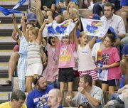 A group of young KU fans cheer for the women's volleyball team during KU's Jayhawk Classic volleyball action Saturday, Sept 4, 2010, against Chattanooga.