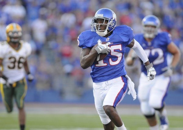 Daymond Patterson (15) finds an open hole for a 51-yard dash in the first quarter Saturday, Sept. 4, 2010 in the home opener Kansas against North Dakota State at Kivisto Field.