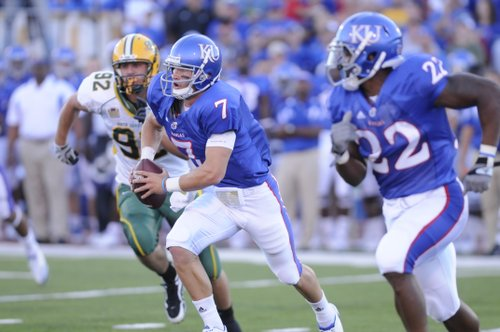 Kansas quarterback Kale Pick (7) scrambles for yards in the first quarter Saturday, Sept. 4, 2010 in the home opener Kansas against North Dakota State at Kivisto Field.