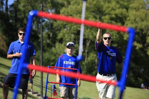 Kansas fans Alex Gilkeson, Wichita sophomore, Reid Abbott, 14, Wichita, and his older brother Logan Abbott, Wichita freshman, watch a shot from Logan as the three play ladder golf on the hill before kickoff, Saturday, Sept. 4, 2010 at Kivisto Field.