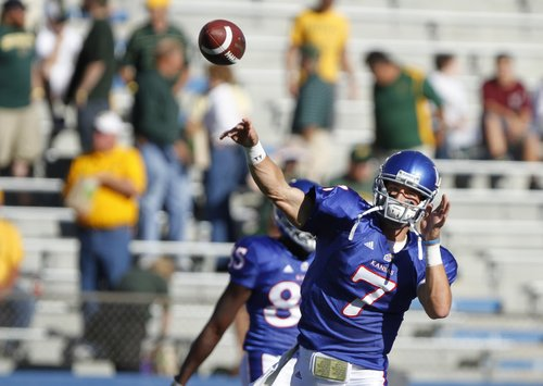 Kansas quarterback Kale Pick warms up before kickoff against North Dakota State University, Saturday, Sept. 4, 2010 at Kivisto Field. Pick will be making his first start as quarterback.