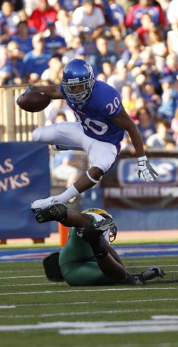 Kansas receiver D.J. Beshears goes airborne as he is tripped up by North Dakota State linebacker Preston Evans on a four yard gain during the first quarter, Saturday, Sept. 4, 2010 at Kivisto Field.