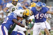 Kansas linebacker Drew Dudley (49) comes in to help as linebacker Steven Johnson (52) drags down North Dakota State running back D.J. McNorton (8) during the second quarter, Saturday, Sept. 4, 2010 at Kivisto Field.