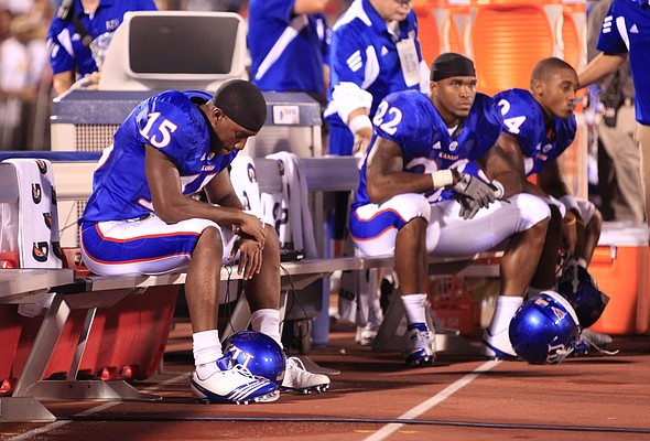 Kansas receiver Daymond Patterson (15) hangs his head on the bench as time expires against North Dakota State, Saturday, Sept. 4, 2010 at Kivisto Field. At right is running back Angus Quigley (22) and receiver Bradley McDougald (24).