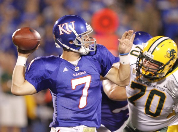 Kansas quarterback Kale Pick pulls back to pass as he is hit by North Dakota State defensive tackle Matthew Gratzek during the fourth quarter, Saturday, Sept. 4, 2010 at Kivisto Field.