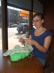 Carrie Wendel-Hummell,  Lawrence, knits a piece of clothing for her daughter; she hasn't decided yet whether it will be a skirt or a dress. She's part of the Lawrence Stitch 'n' Bitch club.