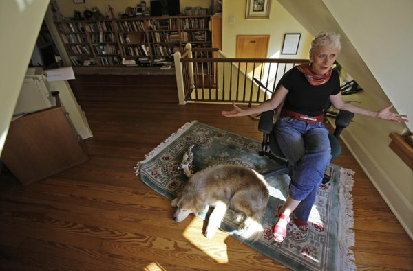 "Author Sara Paretsky and dog Callie are seen during an interview in October, 2010, at her Chicago home. Paretsky's latest book, ""Body Work,"" is the 14th in her series about feisty female private detective V.I. Warshawski."