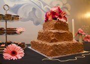 Chocolate buttercream and raspberry wedding cake by Nikki Overfelt.