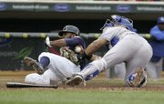 Minnesota's Denard Span, left, is tagged out by Kansas City Royals catcher Brayan Pena. No matter. The Twins still won, 5-4, on Monday in Minneapolis.