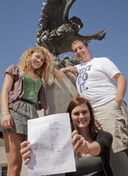 Free State High School seniors, from left, Audrey Hughes, Bailey Knowlton and Connor Caldwell were instrumental in a petition drive to get some students added to the Homecoming Court ballot. Knowlton holds one of the signed petitions Tuesday at Free State.