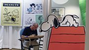 Rich LaPierre, a Hallmark Cards Inc. designer for the Peanuts line, works on artwork during a 100-year anniversary reception at the company's headquarters July 20 in Kansas City, Mo. Hallmark Cards Inc., a $4 billion empire built on a demand for printed sentimentality, enters its second century facing a weak economy and what could be an even greater challenge: a generation that has grown up posting its sentiments online.